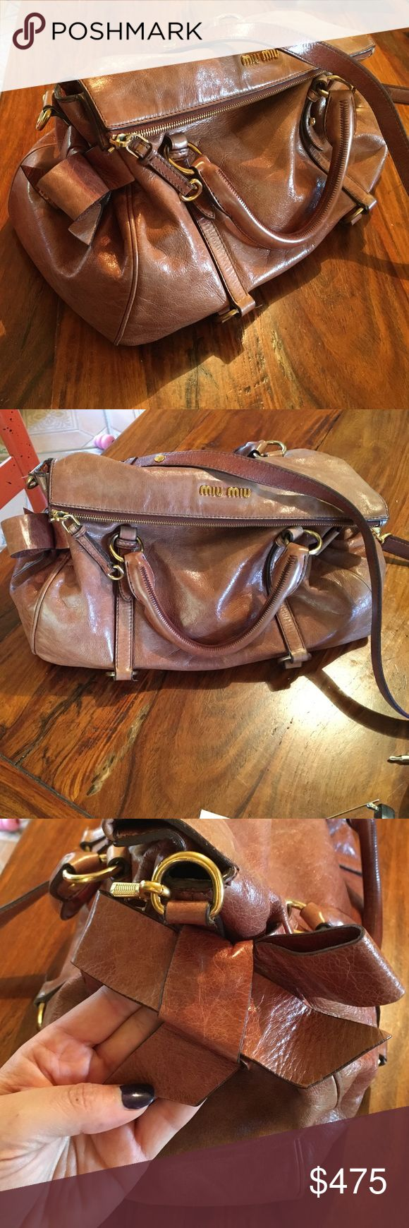 Miu Miu bow bag large Brown bow bag AUTHENTIC bow bag. Lovely soft leather from light use. Very roomy with a long cross body strap and two adorable bows on the sides. Slight fading on top of bag and I do not have the dust bag - price reflects the use. Serious inquiries only thanks! Will consider partial trade for botkier, liebskind. Thanks. Miu Miu Bags Hobos