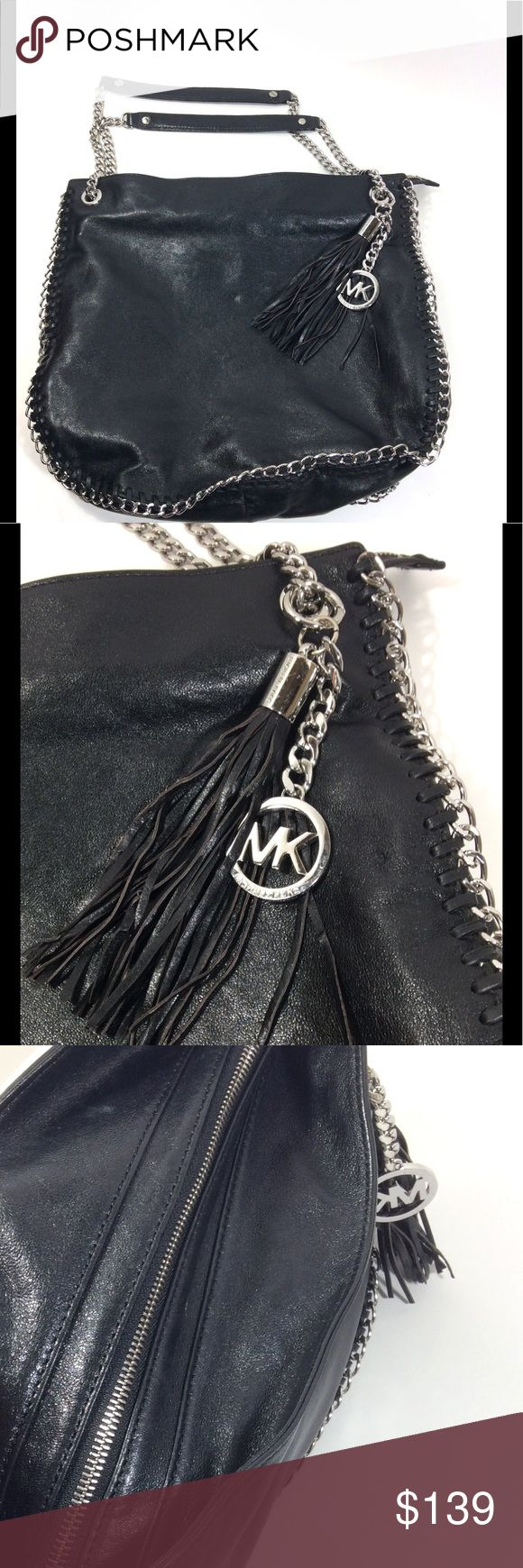 Michael Kors Chelsea Black Leather Bag Michael Kors Chelsea Black Leather Bag. Silver Hardware, gorgeous chain top handles, hanging MK logo charm with accent of leather tassel. Slouchy body with interwoven chain trim. This bag is gorgeous and in great condition. Normal scratching on hardware, tassel show minor use. Beautiful bag!! Michael Kors Bags Shoulder Bags