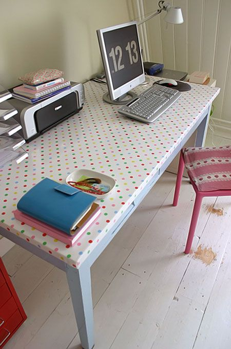 Definitely trying this with my $5 desk project! Perfect way to cover the old laminate top