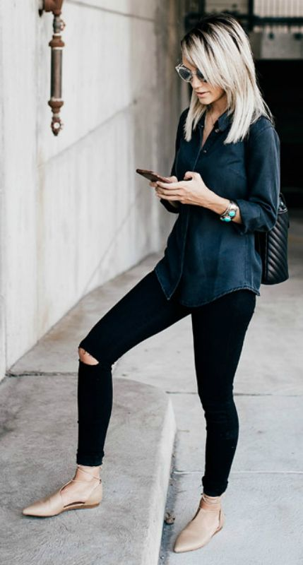 Black jeans, green shirt, nude flats, black backpack, aviator glasses
