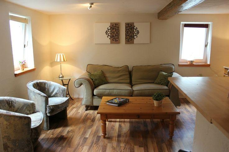 De woonkamer van appartement 1 in vakantiehuis de Steenenhoeve