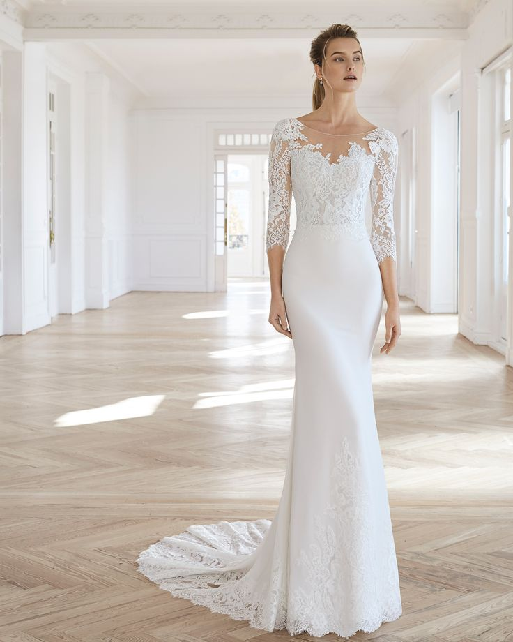 Sheath-style wedding dress in crepe Georgette and beaded lace. Illusion neckline…