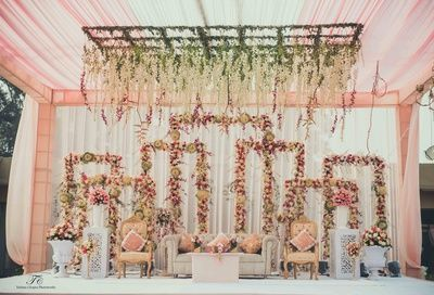 pastel pink decor, dull pink curtain drapes, green floral ceiling, pink floral backdrops, pastel pink cushions