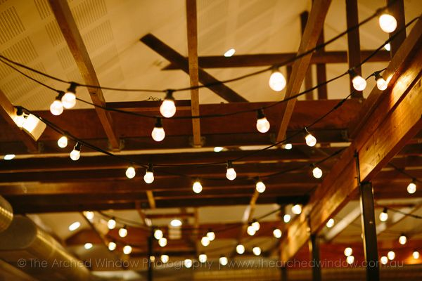 hanging light bulbs styled for a wedding reception. Wedding venue Babalou Kingscliff. Photography by The Arched Window.