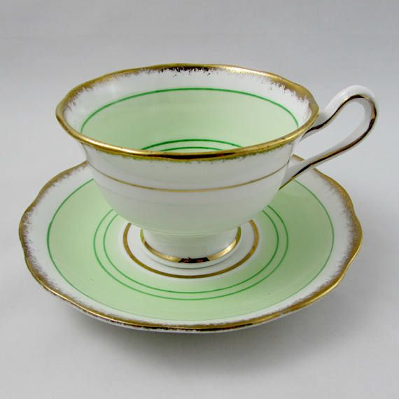 Made by Royal Albert, tea cup and saucer are green with stripes and gold trimming. Excellent condition (see photos). Markings read: Royal Albert Crown China Made in England Please bear in mind that these are vintage items and there may be small imperfections from age or flaws from