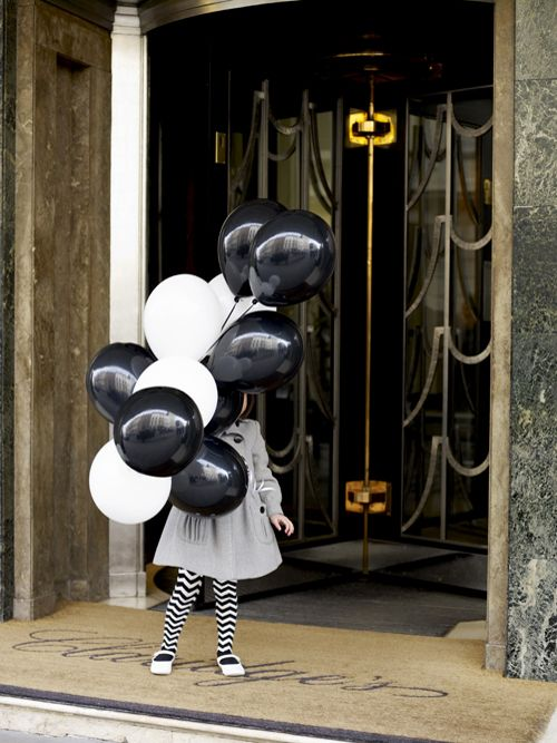 black and white outfit. black and white balloons. find colorful 'backdrop'. take picture.