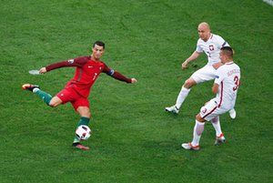 Ronaldo attempts a shot under pressure from Poland's Michal Pazdan and Artur Jedrzejczyk.