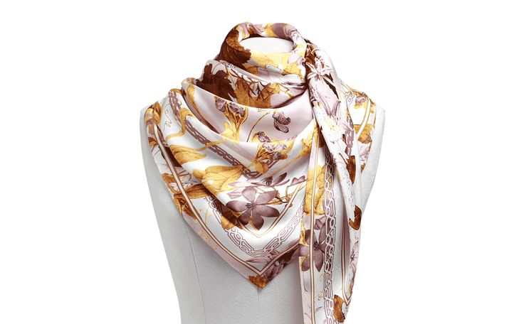 Handcrafted in Italy with the finest satin chiffon and printed with a bespoke floral design, each scarf is delicately stitched and edged with a hand roll hem.