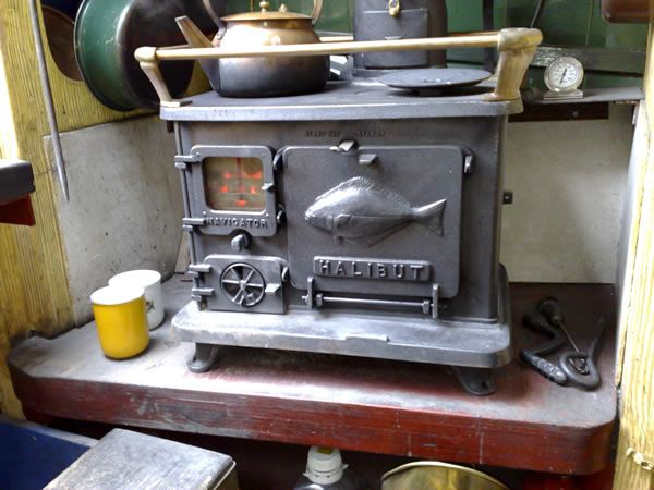 HALIBUT COOKSTOVE for both heat and cooking. This tiny thing is efficient,  burns wood or coal, and the perfect size for a Tiny Home. - 114 Best Tiny Home Wood Stoves For Heat/Cooking. More On Truck