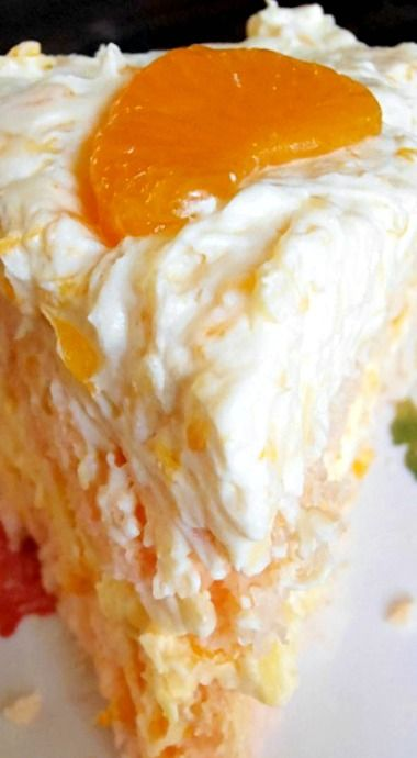 Orange Coconut Cake...A moist orange and coconut cake is frosted with even more orange and coconut. It is truly divine!!