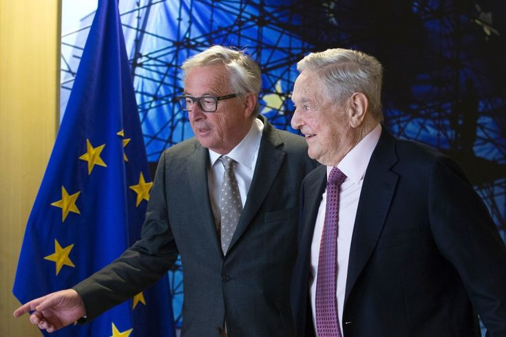Jean-Claude Juncker Photos - EU commission President Jean-Claude Juncker (L) welcomes George Soros, Founder and Chairman of the Open Society Foundations prior to a meeting in Brussels, on April 27, 2017. .Meeting will mainly focus on situation in Hungary, including legislative measures that could force the closure of the Central European University in Budapest. / AFP PHOTO / POOL / OLIVIER HOSLET - Georges Soros Meets EU Commission President Jean-Claude Juncker for Talks Focusing on Hungary