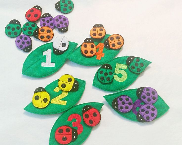"F elt lady bug counting and color matching game. Game has a total of 27 pieces. Leaves measure about 6"" X 3"" and lady bugs measure about 2"" X 1 1/2"" Children match the black spots on the lady bugs wit"