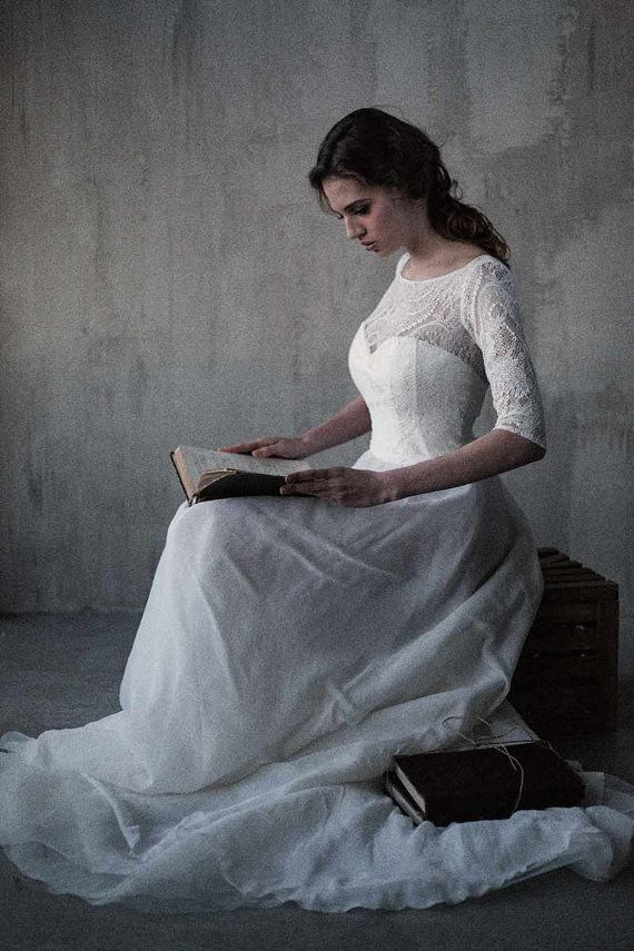 Vintage inspired wedding dress with a lace bodice by CathyTelle