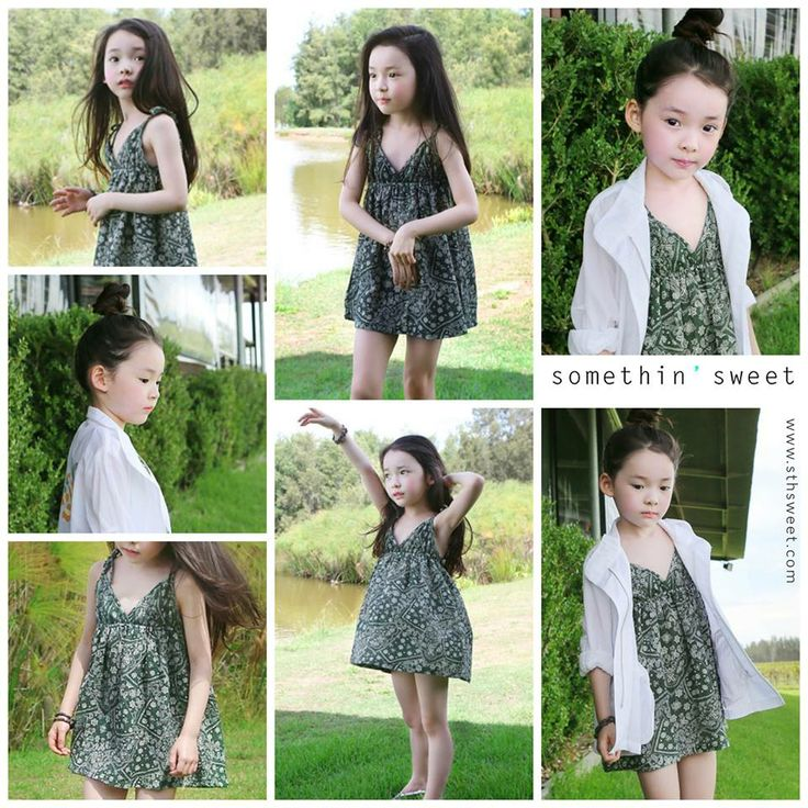 cute little Asian girl pulling off a pretty green dress.