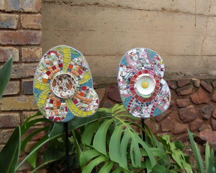 Mosaic garden flowers. Made with glass tiles and broken china. Christmas presents for my sisters