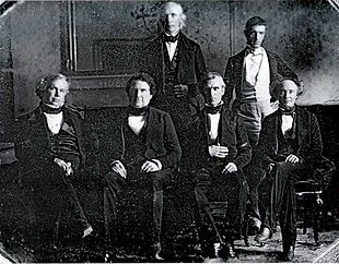Polk and his cabinet in the White House dining room. Front row, left to right: John Y. Mason, William L. Marcy, James K. Polk, Robert J. Walker Back row, left to right: Cave Johnson, George Bancroft Secretary of State James Buchanan is absent.
