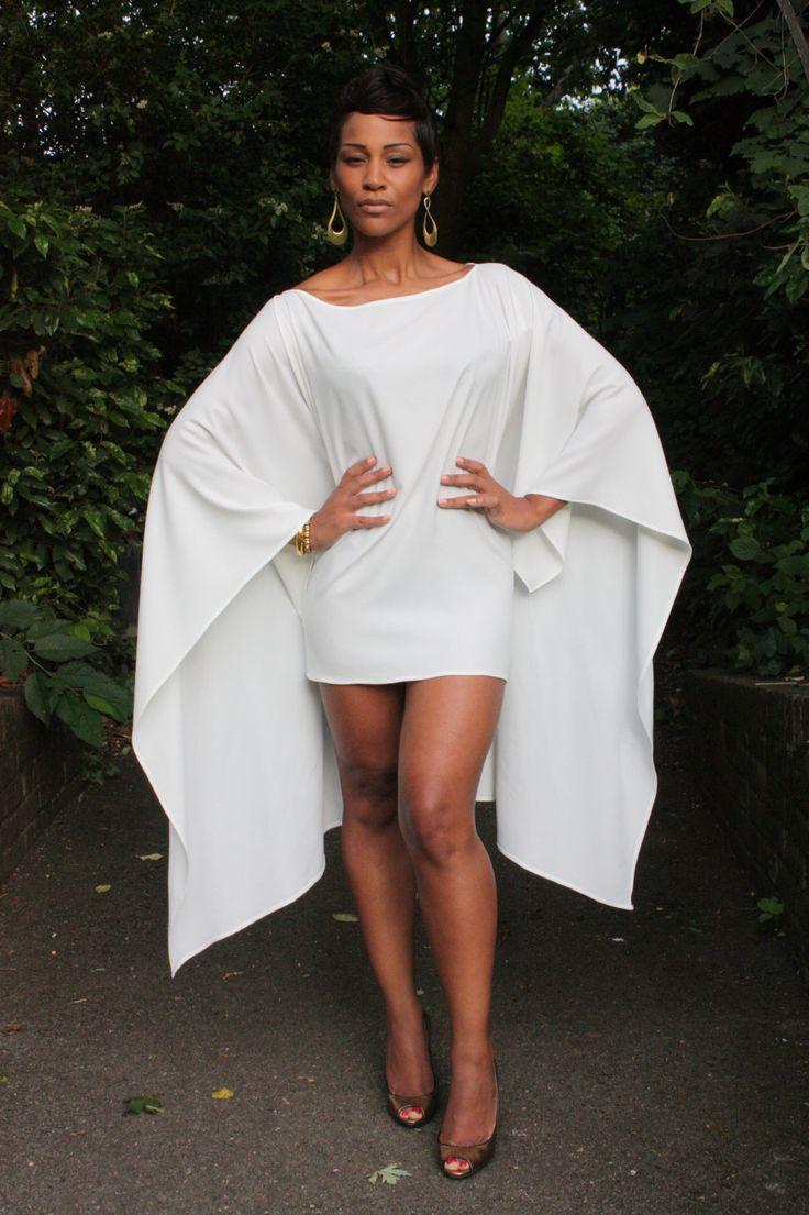 "Beautiful white ""cape dress"" by Gaya Zahari Couture"