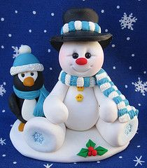 Fimo snowman and penguin cake topper (without the creepy eye wrinkles)