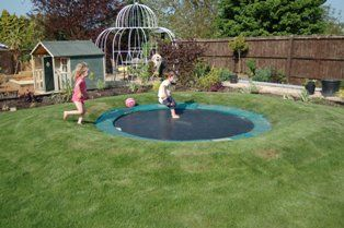 A sunken trampoline. Great idea for those who are worried about the