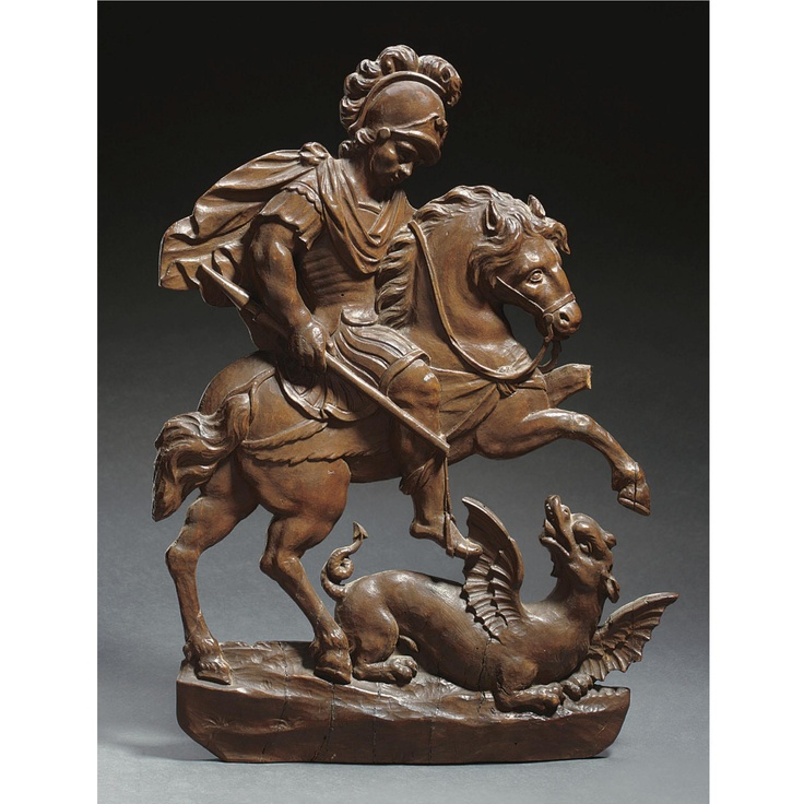 ST. GEORGE AND THE DRAGON,  FRANCO-FLEMISH, SECOND HALF 17TH CENTURY carved walnut relief, the equestrian figure with spear in hand, the dragon struggling beneath