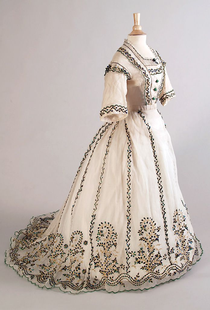 Recreate this dress circa 1865 with our Janna Embroidered Cotton fabric!   Visit www.fabricandmore.net and order by the meter.