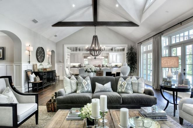Love the openness, large paneled windows, tall curtains, wainscoting, industrial cozy