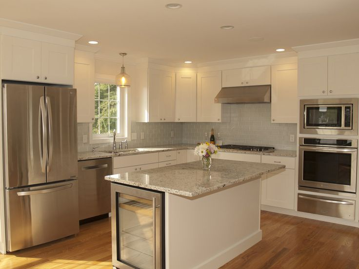 Open Concept Kitchen With White Cabinetry Light Granite