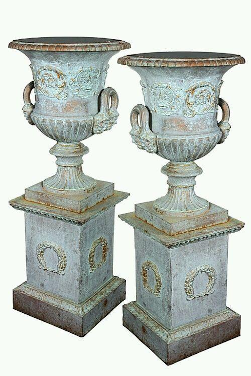 A Pair Of Antique Verdigris Urns