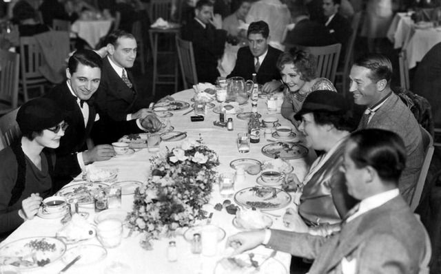 Luncheon party for Elsa Maxwell at the Paramount commissary early 1930's: Sylvia Sidney (wearing sun glasses), Cary Grant, screenwriter Ben Glazer, director A. Edward Sutherland, Nancy Carroll, Maurice Chevalier and Ms Maxwell.