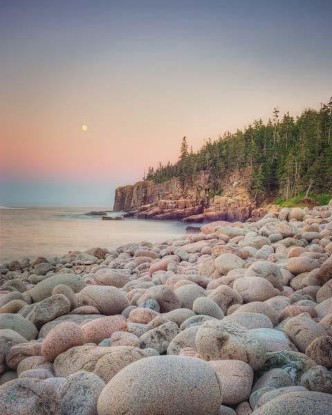 Fine art landscape photography print of a moonrise over round rocks on the coastline at Acadia National Park, Maine by Allison Trentelman.