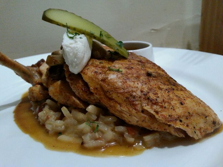 Paprika chicken on a bwd of tomato risotto with mushroom sauce