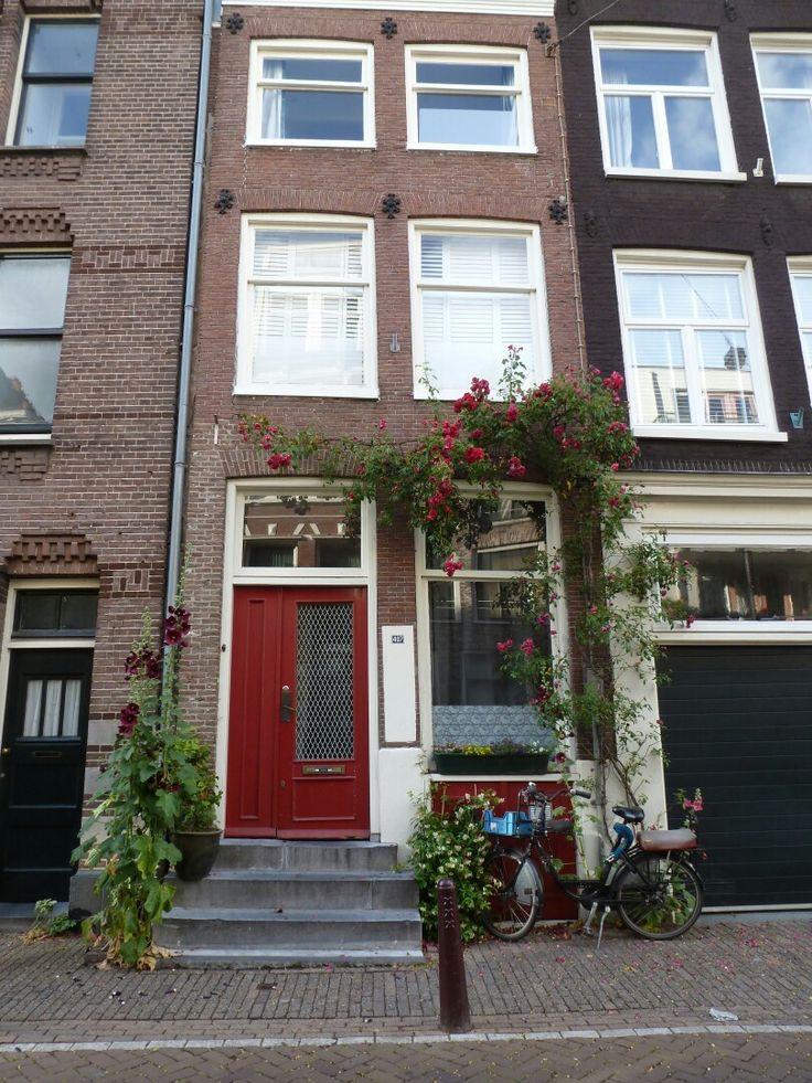 Amsterdam's house. #bricks #flowers #bike #reddoor