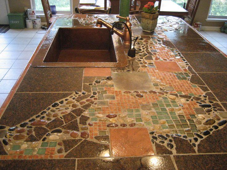 mosaic countertop, river rocks, glass tiles, granite- by nancy Miller