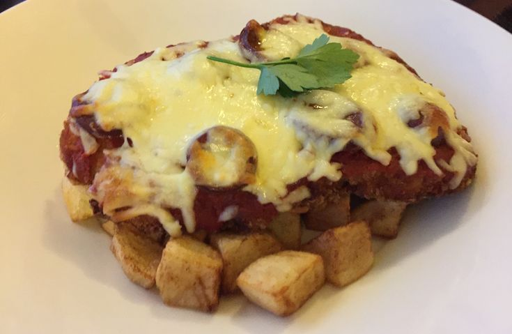 Spanish chicken parma from Omni, Essendon
