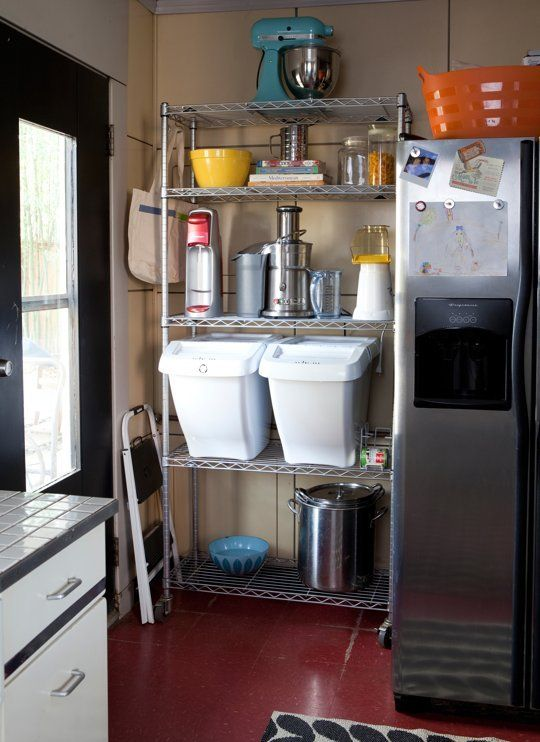 Like the idea of using the 'hot' space beside a fridge or stove as vertical shelving for kitchen gadgets and cookware. 20 Organized Kitchens from Real Cooks