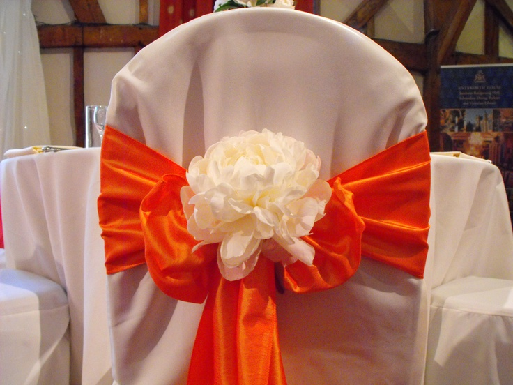 Orange Satin Bow with flower on White Chair Cover