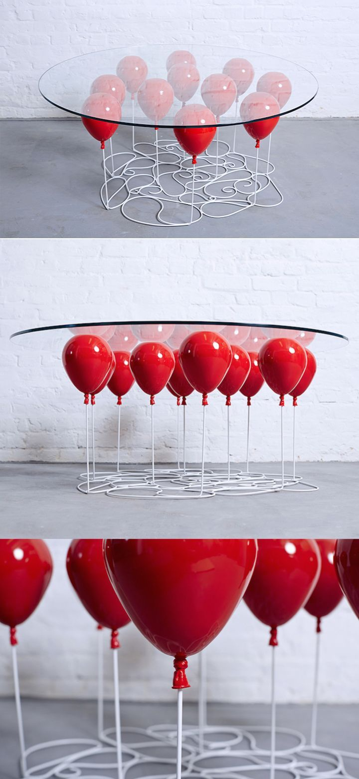 "Christopher Duffy of Duffy London created a playful ""Up"" table that looks like it's floating on a bunch of balloons.  balloons 