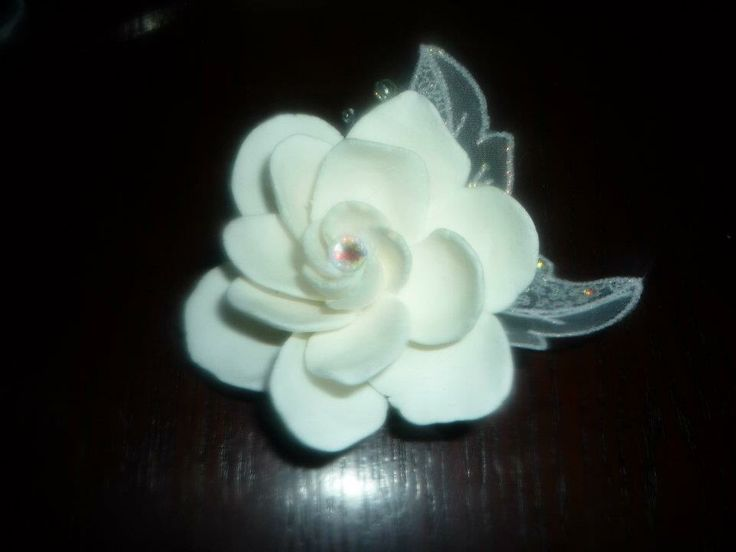 Paper clay magnolia flower  hair clip, with lace leaves.