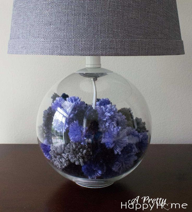 lamp base filled with yarn pom poms
