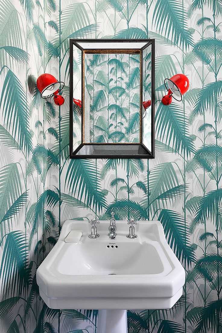 Wall sconces add a pop of red to the delightful powder room [Design: Turner Pocock]