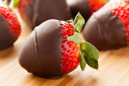 Dark Chocolate Covered Strawberries - This sweet treat is made with dark chocolate and Coconut Oil for an extra health boost!