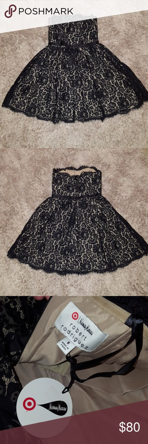 NWT Neiman Marcus dress! NWT! Neiman Marcus Robert Rodriguez dress. Size 8 with tags. Black lace detail top layer. Multi layer underneath. Zipper back. See picture for length. Wire in bodice top. Bow on the front. Super cute detail. Lovely dress!   Please ask if you need further details.  I am not responsible if clothing does not fit. Neiman Marcus Dresses Strapless