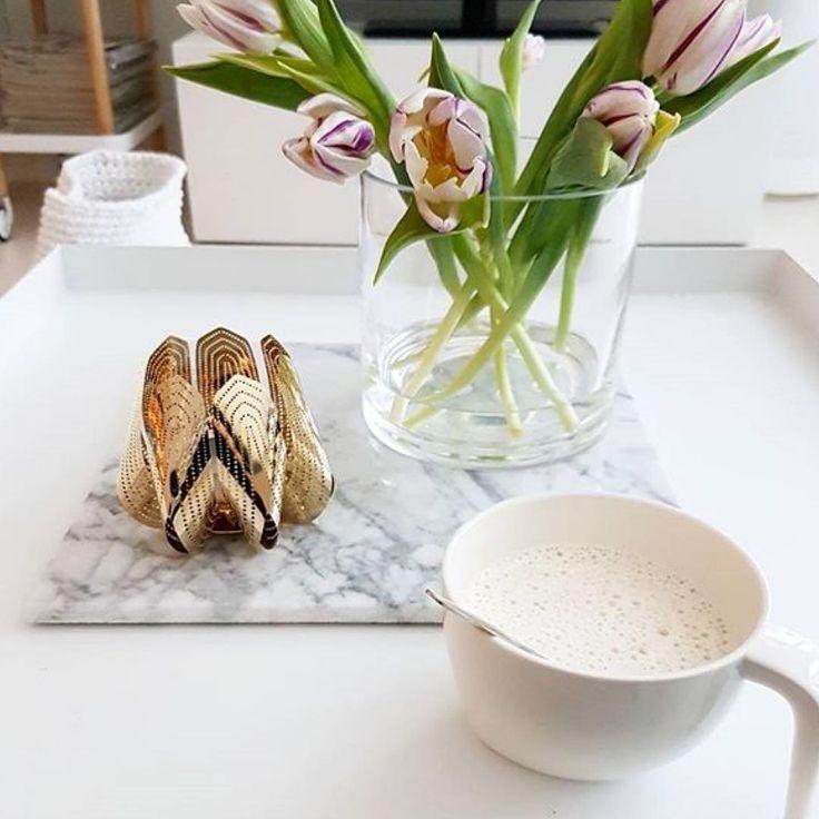 Golden blossom tea light holder and morning coffee