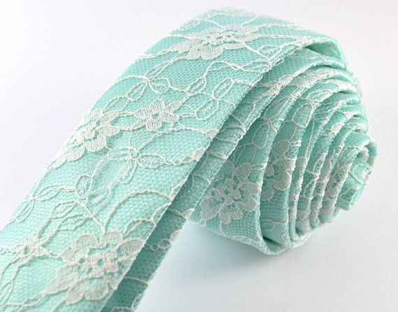This is a MADE TO ORDER ITEM - the current production time for each tie is 7 business days.  This handmade necktie features a romantic lace overlay and could be a unique gift for a loved one!  • Comes in four different widths - please select the desired width when ordering. • White or cream lace over mint green satin. Please select either white or cream from the drop-down menu when ordering. • Lightweight and delicate. • Approximately 57 (145 cm) long. • Cut on the bias, so that the tie…