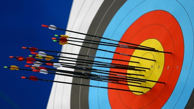 Hitting the target at Beijing 2008  A detail of arrows in a target during competition in the men's Individual Archery ranking round at the Beijing 2008 Olympic Games.