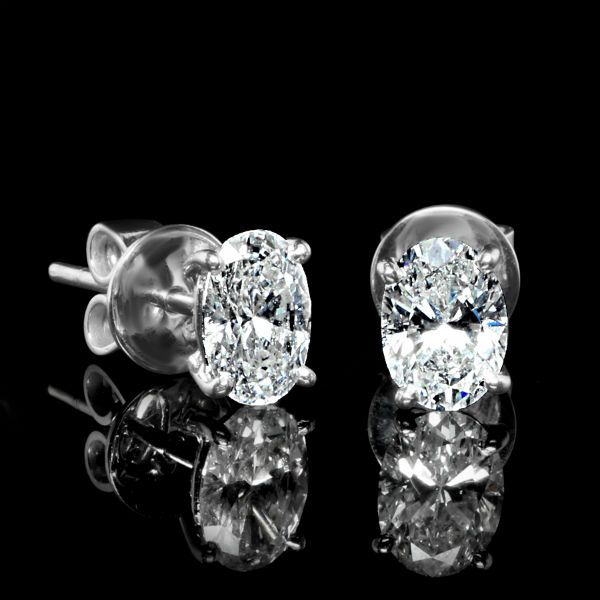 1.50 CTW Oval Diamond Earrings.  Diamond Exchange Dallas carries a large selection of diamond earrings.  Find out more about our services on http://diamondexchangedallas.com