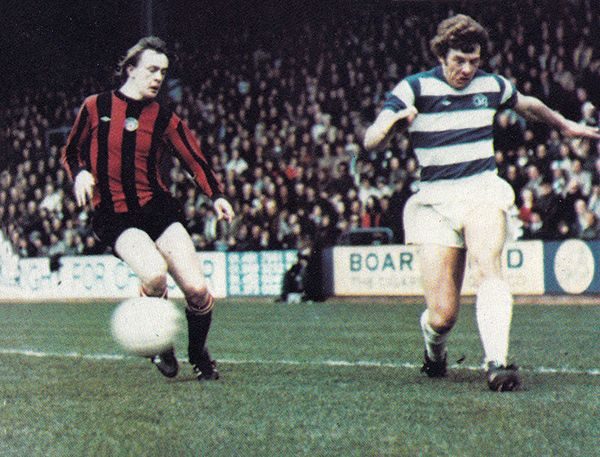 15th March 1976. Queens Park Rangers full back Ian Gillard forcing Manchester City's young star winger Peter Barnes to chase back, at Loftus Road.