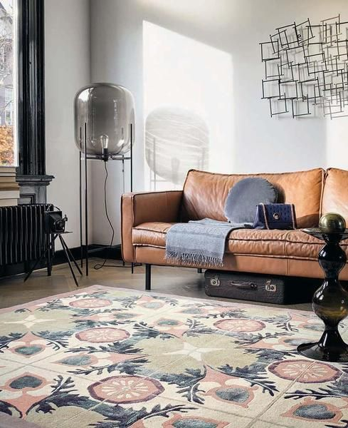 This gorgeous new designer rug from Ted baker features a stunning symmetrical pattern finished wool & viscose