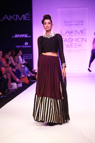 Black Silk Mul Kurta with Embroidered Neckline worn with Purple Mul Lehenga. Shop The Look at http://www.payalsinghal.com/off-the-runway/rumana-lehenga