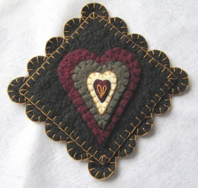 Heart Mug Rug, hand made with wool felt, hand embroidered.
